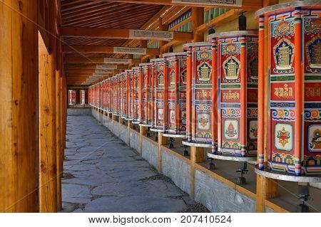 The Tibetan kora or pilgrimage and prayer wheels in Xiahe (Labrang) Amdo Tibet - China. Pic was taken in September 2017. poster