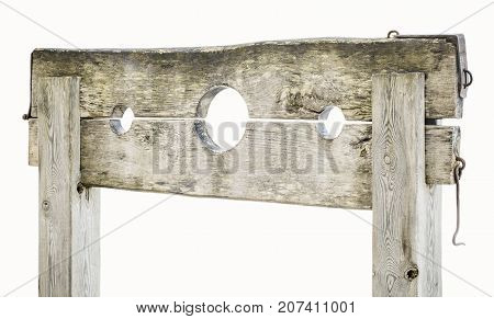 Wooden medieval pillory on white in backgrounds