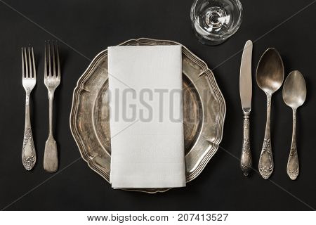 Vintage Dish With Silverware For Lunch On Black Background. Table Place Setting.