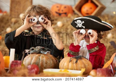 Children making funny daces with plastic eyeballs