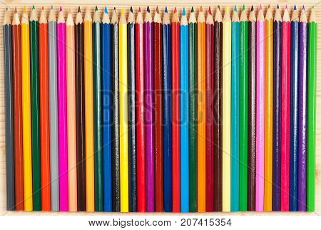 Bright colour pencils for drawing over wooden surface