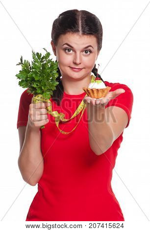 Young woman has alternative to a healthy food isolated on white background