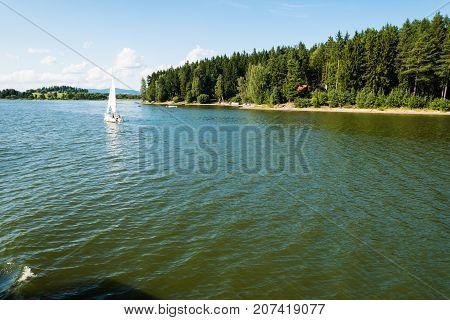 Small Yacht Sailing On Lake