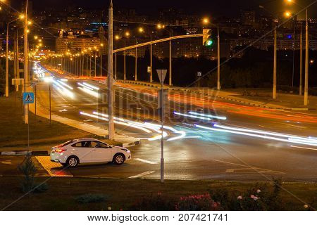 View from Side of flyover,blurred motion effect with light trails.