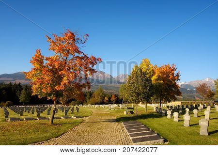 VAZEC, SLOVAKA - OCTOBER 1, 2017 : German military cemetery in autumn with High Tatras mountains in the background and many graves of german soldiers killed in the Second World War.