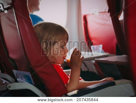 little girl drinking water in flight, avoid dehydration, flight safety