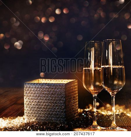 Bright radiant gift box with champagne and bokeh background for congratulation