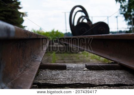 Old rusty metal rails and other metal rolling in the museum exposition.
