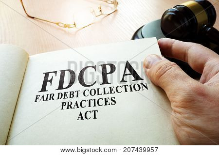 Fair Debt Collection Practices Act FDCPA on a table.
