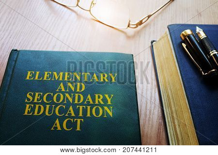Elementary and Secondary Education Act of 1965 (ESEA) on a desk.