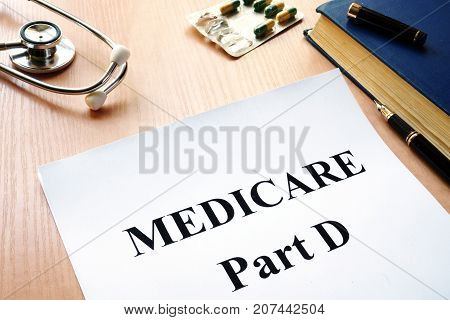 Medicare Part D on a table. Healthcare insurance.