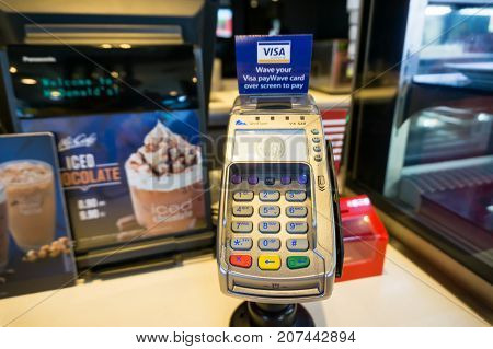 Kota Kinabalu Malaysia - October 05 2017: Credit and debit card reader at the cash register at McDonald McCafe restaurant.
