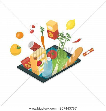 Fresh vegetables and grocery products bursting from a digital tablet online grocery shopping and food app concept