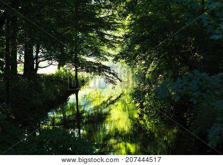 Beautiful sunrise with reflections on a small lake