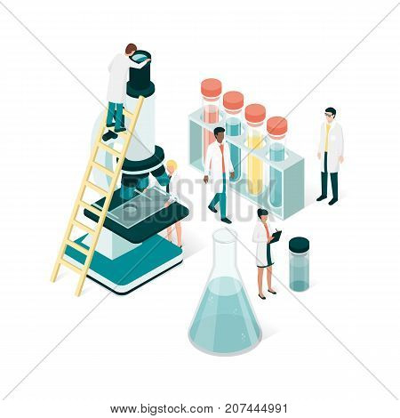 Researchers in the laboratory they are analyzing a sample using a microscope and checking test tubes: science and medical research concept