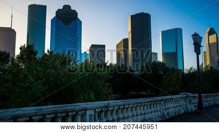 Houston Texas Morning Sunrise at Downtown Skyline Cityscape on Sabine Street bridge overlooking greenbelt at Buffalo Bayou River Park