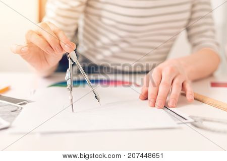 Professional engineering. Close up of a professional drawing being drawn by a nice smart engineer while working on a project
