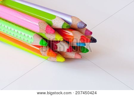 colorful neon penils bound to one bunch