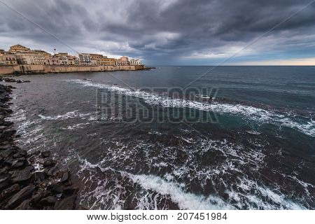 View on Ionian Sea and buildings of the old part of Syracuse - Ortygia isle Sicily Italy