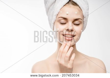 girl with a towel on her head smiling with her eyes closed