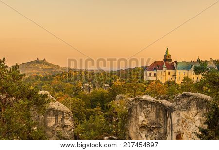Old fantasy castle on the rock in the colorful forest. Hruba Skala and Trosky castle Czech Paradise - Cesky raj Czech Republic