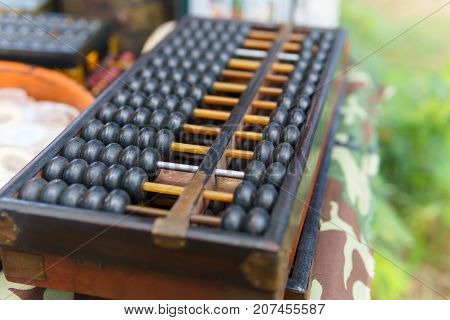close up of wood abacus. chinese vintage calculator use for calculation in business or finance and education.