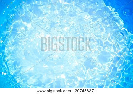 Blue pool water with sun reflections.Shining blue water ripple background.water concept.Save water save the world.