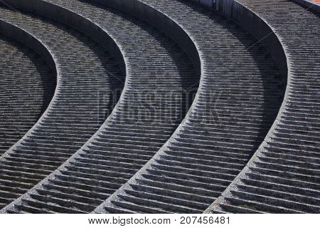 Curved Stone fountain with flowing water Abstract texture