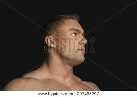 Portrait of a Strong Man on Black Background