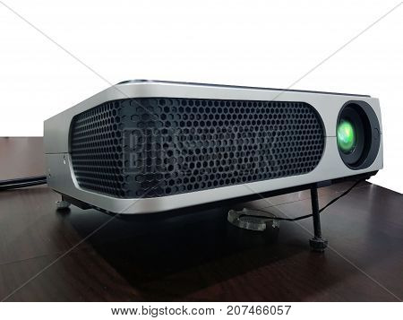LED projector on wood table in a room projector home theater concept.