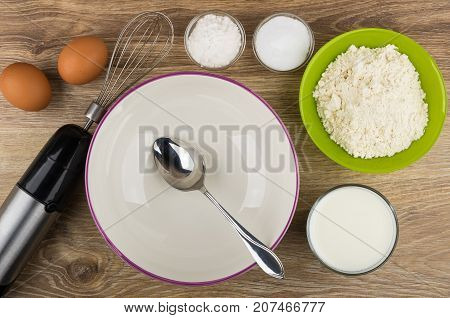 Ingredients For Preparing Pancakes, Empty Bowl And Electric Blender