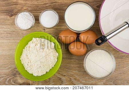 Flour In Bowl, Bowl, Whisk And Other Ingredients For Pancakes