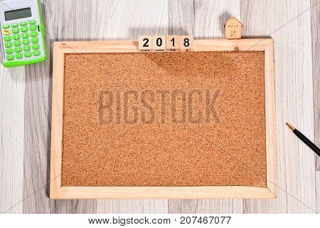 The cork board with wooden frame and 2018 new years cubes for add text