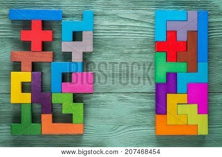 Logical tasks composed of colorful wooden shapes top view. Visual conundrum. Concept of creative logical thinking or problem solving. Business concept rational solution.