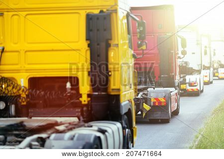 Trucks  waiting in line to pick up cargo
