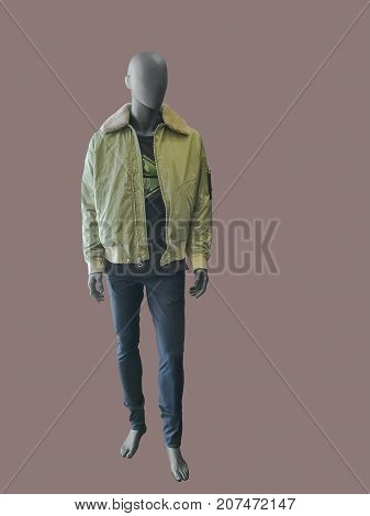 Full length male mannequin dressed in jacket and trousers isolated. No brand names or copyright objects.