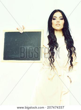 Sexy Girl In Beige Velour Bathrobe Holding Board