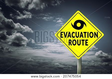 Hurricane evacuation road sign with dramatic sky background