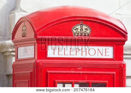 London - october 2017 : red phone box - symbpl of UK capital, telephoto
