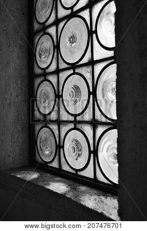 An artistic and symmetric window with circles.
