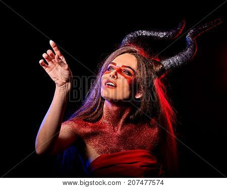 Mad satan woman on black magic ritual of hell. Witch reincarnation mythical creature Sabbath. Devil absorbing soul Halloween. Astral entities. Make-up for night club for demon inflicts damage.