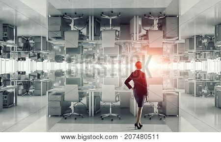 Businesswoman in empty office. Mixed media