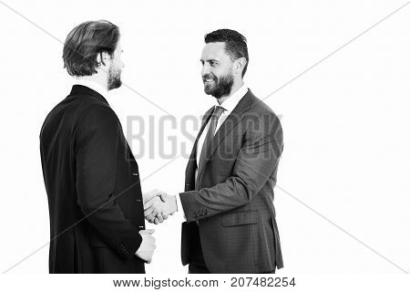 boss and employee happy men in jacket hold hands each other in handshake business and friendship