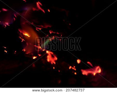 Burning Paper Embers of a Fire in the Dark
