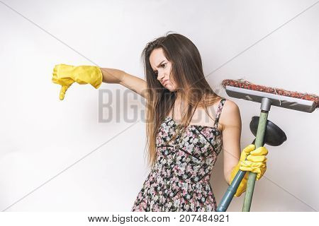 Young stressed sad woman cleaner ,thumbs down
