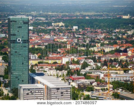 June 12 2017. Wide angle aerial view of the Hochhaus Uptown Munchen building with the logo of Telefonica Europe (O2) on the glass windows. Moosach Munich Germany. Travel and cityscapes editorial.