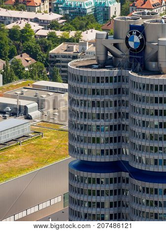 June 12 2017. Close-up vertical aerial view of the top of the BMW-Vierzylinder tower headquarters of the German automobile company BMW. Munich Germany. Travel and business editorial concept.