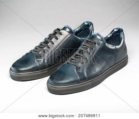 Leather fashion shoes for autumn on a gray background