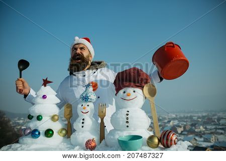 Man Smiling In Chef Hat And Uniform On Winter Day.