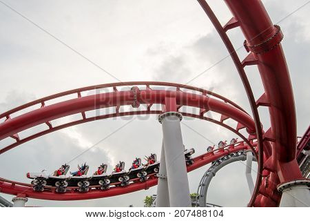 January 3 2017. Tourists scream while riding the red curved rails of the Battlestar Galactica Human vs. Cyclon roller coaster. Universal Studios Sentosa Singapore. Travel and holidays editorial.